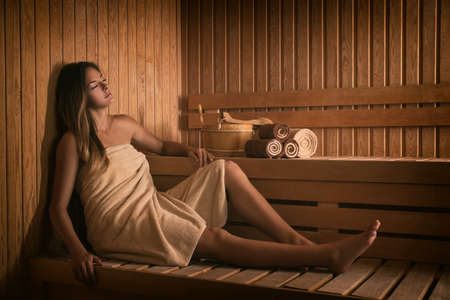 The girl relaxes in a sauna Stock Photo