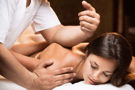 The girl enjoys deep tissue massage