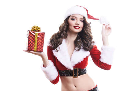 Beautiful young Santa girl with gift on white background. Standard-Bild