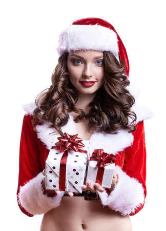 Beautiful young Santa girl with gifts on white background.