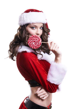 Beautiful young Santa girl with candy on white background.
