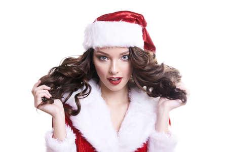 Beautiful happy young Santa girl on white background. Standard-Bild