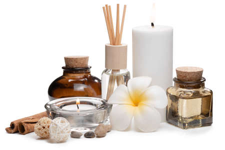 Beautiful spa composition with candles, frangipani flower, oil flasks and other decor elements. Standard-Bild