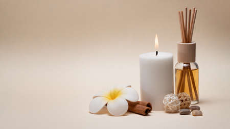 Beautiful spa composition with candle, frangipani flower and other decor elements. Standard-Bild