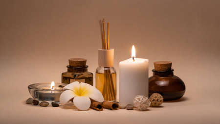 Beautiful spa composition with candles, frangipani flower, oil flasks and other decor elements. Standard-Bild - 131554389