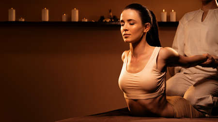 Young pretty woman has Thai massage at luxury spa.