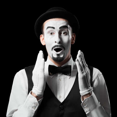 Mime artist expresses surprise emotion Isolated on black