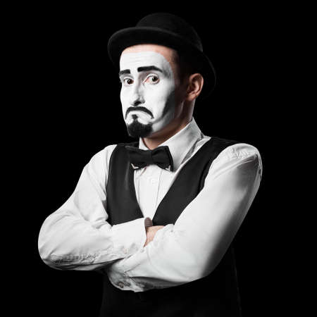 Mime artist shows sadness emotion Isolated on black Standard-Bild - 141965535