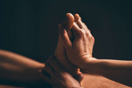 Professional foot massage close up. Authentic shot of luxury spa treatment. Charming light. Shallow depth of field. Stylized and colored. Copy space Standard-Bild - 146998653
