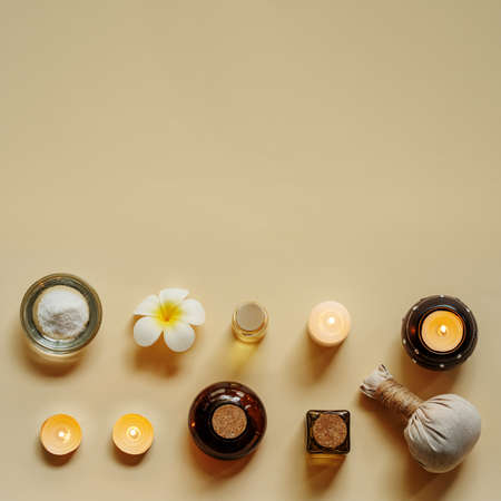 Various spa related objects on beige background, top view. Flat lay with copy space.