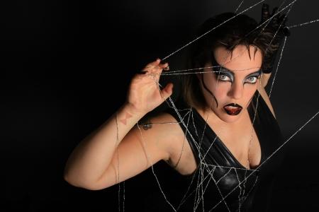 black widow in its web
