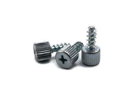 three metal screws with a head on a white isolated background close up 版權商用圖片