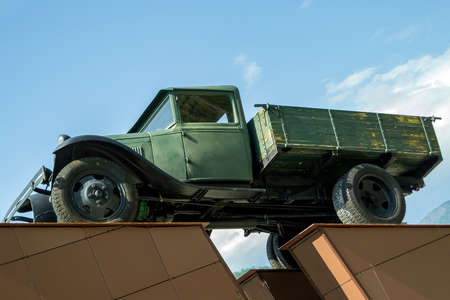 Monument to the old military green truck that was used during the Second World War in the Soviet Union for the transport of goods in the Altai Mountains