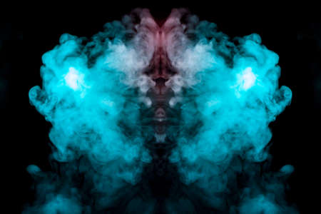 A background of blue, red and green wavy smoke in the shape of a ghost's head or a man of mystical appearance on a black isolated ground. Bright abstract pattern of steam from vape. Standard-Bild