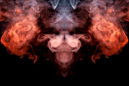 The head of a ghost on a black background from a smoke pattern of an orange-colored vape vaporizing like a flame.