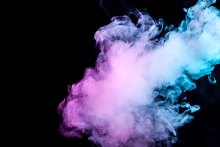 Clouds of isolated colored smoke: blue, red, green, pink; scrolling on a black background in the dark close up.