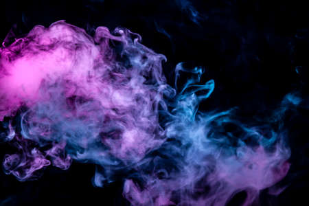 Of pink purple and blue wavy smoke on a black isolated background. Abstract pattern of steam from vape of smoothly rising clouds.