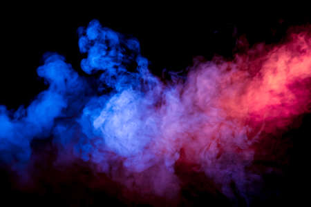 Beautiful horizontal column of smoke in the neon bright light of blue pink and orange on a black background exhaled out of the vape.