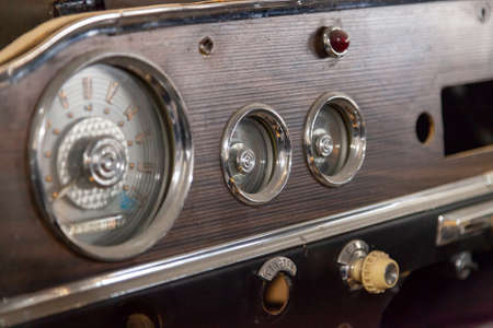 Novosibirsk, Russia - 01.30.2019: Instruments and a panel with a speedometer and a tachometer of an old Russian retro car gas 13 gull chaika executive class, released in the USSR Редакционное