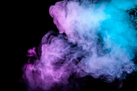 Translucent, thick smoke, illuminated by light against a dark background, divided into three colors: blue, green and purple, burns out, evaporating from a steam of vape for T-shirt print
