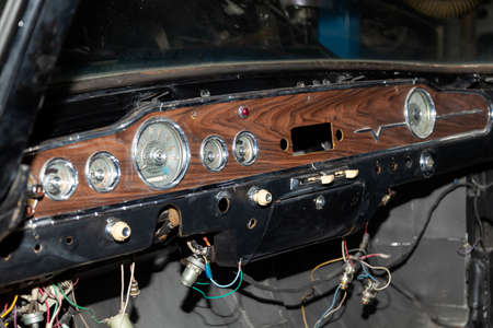 Novosibirsk, Russia - 08.01.2018: Instruments and a panel with a speedometer and a tachometer of an old Russian retro car gas 13 gull chaika executive class, released in the USSR