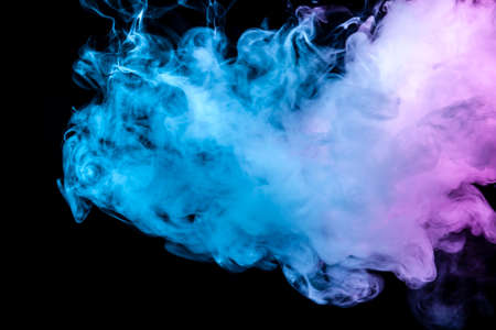 Translucent, thick smoke, illuminated by light against a dark background, divided into three colors: blue, green, pink and purple, burns out, evaporating from a steam of vape for print on t-shirt