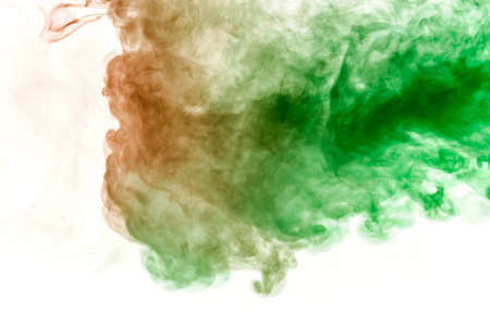 The texture of red smoke is like a watercolor on a white background with transitions of matter between green and orange like a chemical reaction for printing on t-shirt and clothes Stock fotó