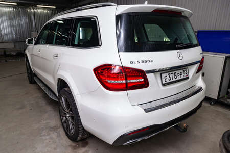 Novosibirsk, Russia - 08.01.18: Rear view of luxury very expensive new white Mercedes-Benz GLS 350d car stands in the washing box waiting for repair in auto service