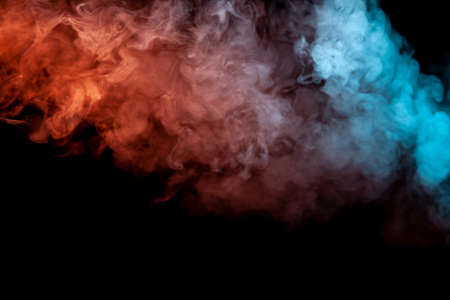 Background of orange, purple, red and blue wavy smoke on a black isolated ground. Abstract pattern of steam from vape of smoothly rising clubs. Mocap and print for t-shirt.