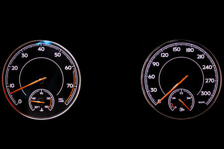 The dashboard of the car is glowing blue with red arrows at night with a speedometer, tachometer and other tools to monitor the condition of the vehicle in modern style on black isolated background