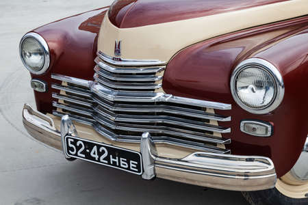 Novosibirsk, Russia - 05.01.2019: Front view of the double colored brown and beige old Russian car released in the Soviet Union Black GAZ m20 pobeda victory that used in second world war