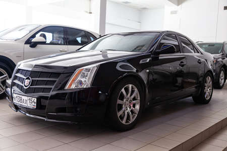 Novosibirsk, Russia - 08.01.2018: Front view of Cadillac CTS in black color after cleaning before sale in a sunny day and on parking in dealership