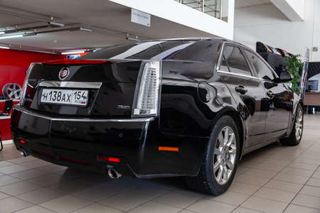 Novosibirsk, Russia - 03.10.2019: Rear view of Cadillac CTS in black color after cleaning before sale in a sunny day and on parking in dealership