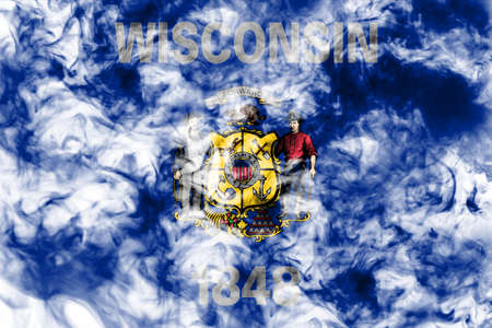 The national flag of the US state Wisconsin in against a gray smoke on the day of independence in different colors of blue red and yellow. Political and religious disputes, customs and delivery.