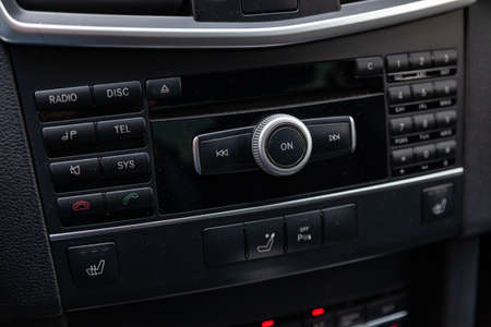 Control buttons for multimedia system, phone connected via bluetooth for talking on the speakerphone in the car on the black panel, heated seats and parking sensors.