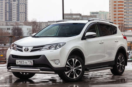 Novosibirsk, Russia - 07.25.2019: Front view of Toyota RAV4 2015 year in white color after cleaning before sale on parking. Auto service industry.