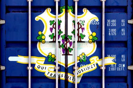 The national flag of the US state Connecticut in a container doors on the day of independence in different colors of blue red and yellow. Political and religious disputes, customs and delivery.