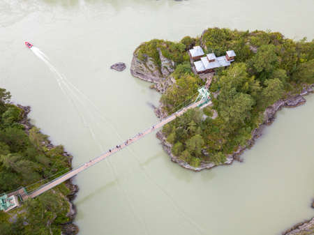 Aerial view of a landmark in the Altai Territory Patmos Island with a monastery church and a suspended wooden bridge.