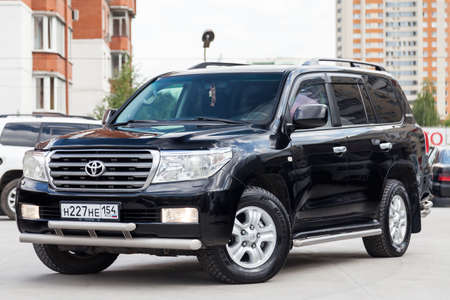 Novosibirsk, Russia - 08.09.2019: Front view of Toyota Land Cruiser 200 in black color after cleaning before sale in a sunny day on parking