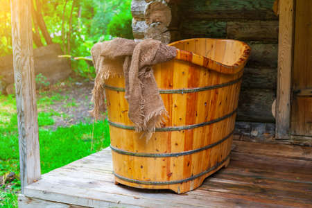 Old Russian bath made by hand from a tree for washing and relaxing in nature far from the bustle of the city. Health and outdoor recreation. Water treatments