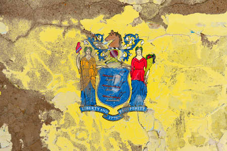 New Jersey grunge, damaged, scratch, old style state flag on wall. Stockfoto