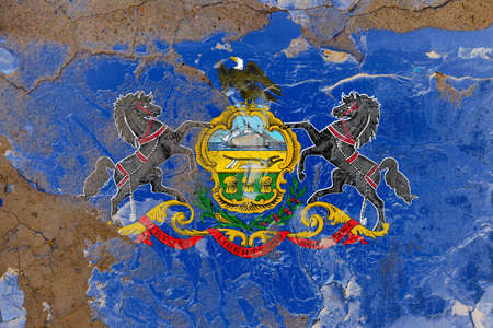 Pennsylvania grunge, damaged, scratch, old style state flag on wall. Banco de Imagens