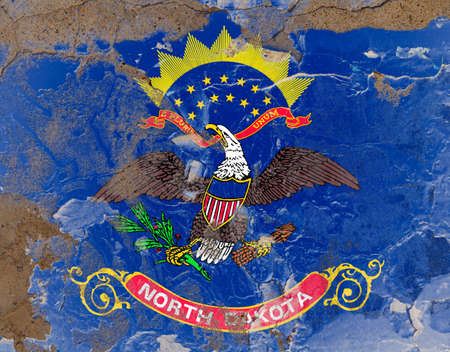 North Dakota grunge, damaged, scratch, old style state flag on wall.