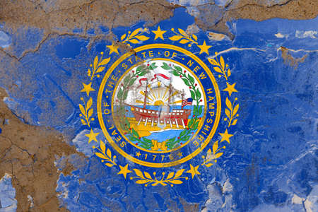 New Hampshire grunge, damaged, scratch, old style state flag on wall.