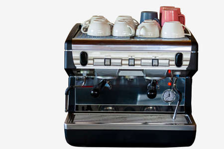 Electric coffee machine with mugs on top in a bar or cafe for making delicious drinks on white isolated background. Reklamní fotografie