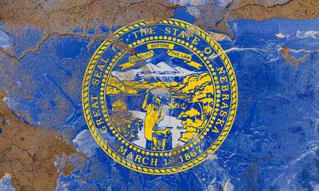 Nebraska grunge, damaged, scratch, old style state flag on wall.