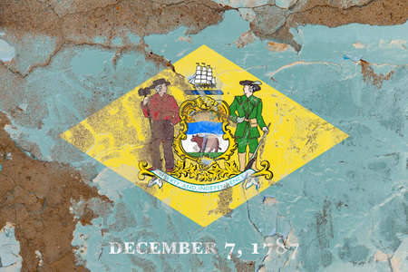 Delaware grunge, damaged, scratch, old style state flag on wall. Stockfoto