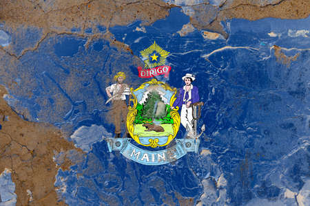 Maine grunge, damaged, scratch, old style state flag on wall.