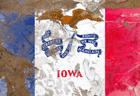 Iowa grunge, damaged, scratch, old style state flag on wall.