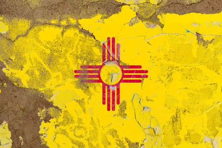 New Mexico grunge, damaged, scratch, old style state flag on wall. Stockfoto